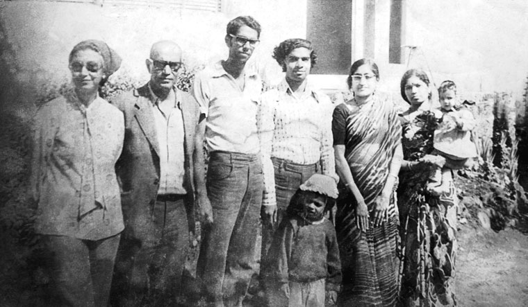 Bonding times: Ghandy (third from left) with his parents (next to him on the left) and friends