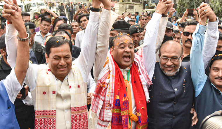 Show of support: BJP leader Himanta Biswa Sarma flanked by Sonowal (left) and Manipur Chief Minister Biren Singh before filing his nomination | PTI