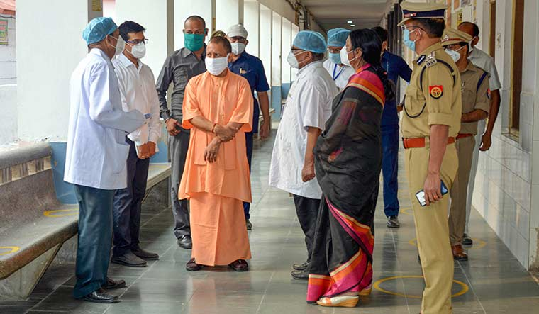 Robust system: Yogi Adityanath with medics during his visit to a hospital in Azamgarh | PTI
