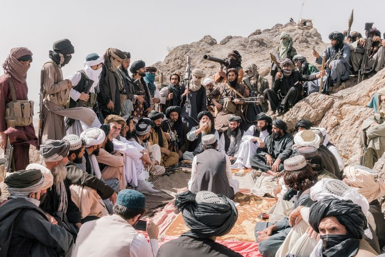 Tough lessons: Mullah Abdul Manan Niazi, a senior leader of a Taliban faction, with his followers in Herat.