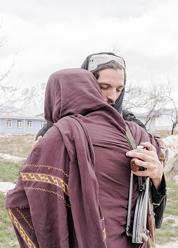 Friends in need: Two Taliban fighters greet each other during a meeting in Nerkh in Wardak province   Emanuele Satolli