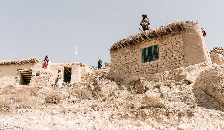 Keeping vigil: Fighters of a Taliban faction stand guard in Herat province | Emanuele Satolli