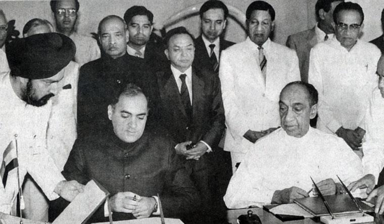 The price of peace: Rajiv Gandhi and Sri Lankan president J.R. Jayewardene sign the India-Sri Lanka Accord in 1987. Rajiv's involvement in Sri Lankan politics cost him his life