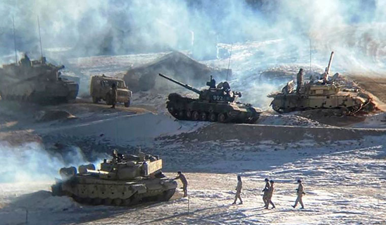Break to provocation: Chinese soldiers and tanks during military disengagement along the Line of Actual Control | AFP