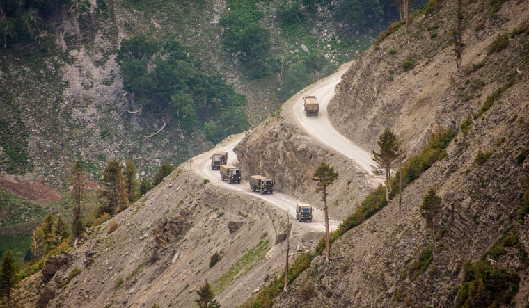 Support Ensured:  An Indian Army convoy, carrying reinforcements and supplies, travels towards Leh through Zoji La Pass | Getty Images
