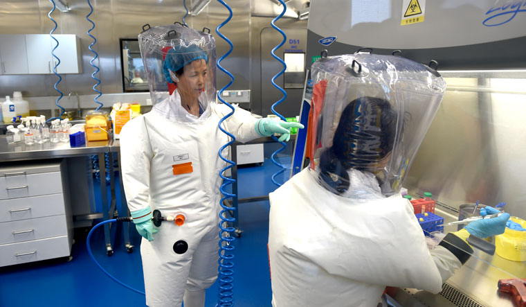 Uncovering truths: A file photo of virologist Shi Zhengli (left), with a colleague at the P4 lab of Wuhan Institute of Virology, China | Getty Images
