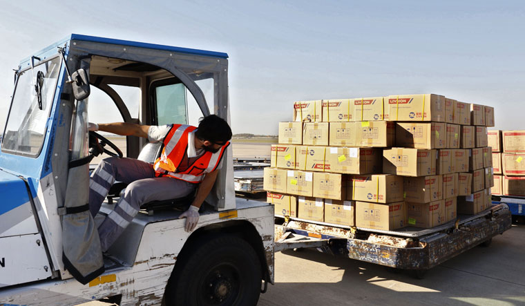 Antiviral load: A worker in Argentina unloading boxes containing medical supplies sent by China for the fight against Covid-19   AFP