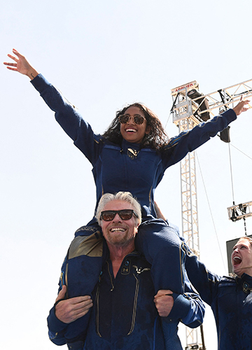 Moment of triumph: Richard Branson with Sirisha after their space voyage | AFP