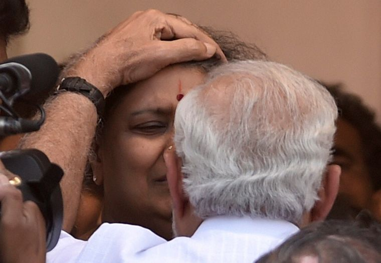 Prime Minister Narendra Modi consoles Sasikala, after paying his last respects to Jayalalithaa in Chennai | PTI