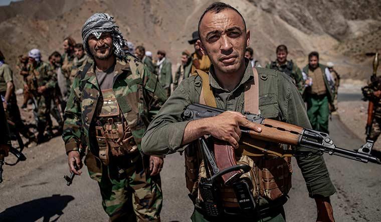 Uphill struggle: Militia members fighting the Taliban in Parwan province.