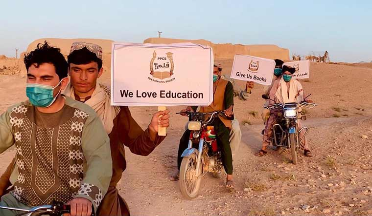 Learning to live: Volunteers of Penpath, an NGO that reopened many schools shut by war in rural Afghanistan.