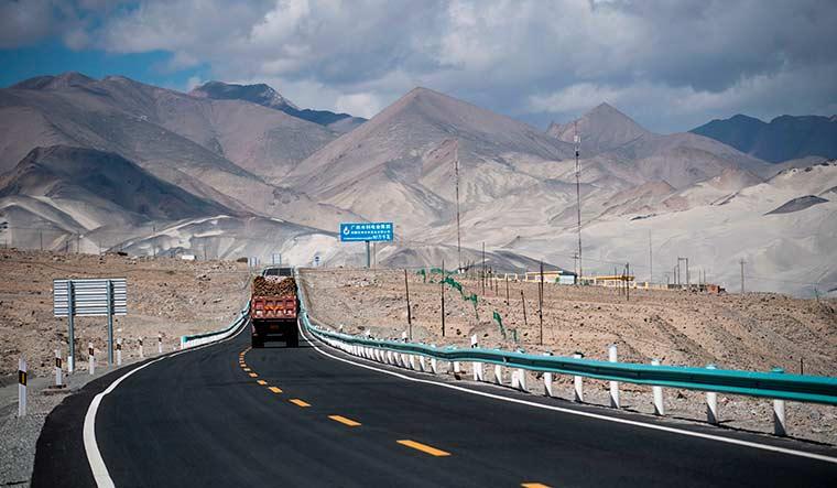 Binding paths: A truck drives along the China-Pakistan Friendship Highway before the Karakoram mountain range near Tashkurgan in China's Xinjiang province | AFP