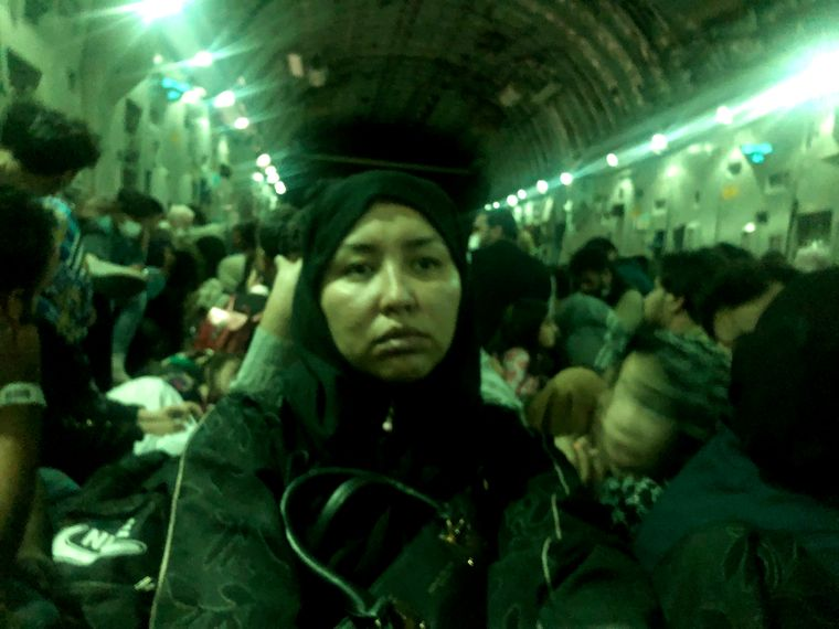 Uncertain future: Salima Mazari in an aircraft with other refugees | Azizullah Ahmadi