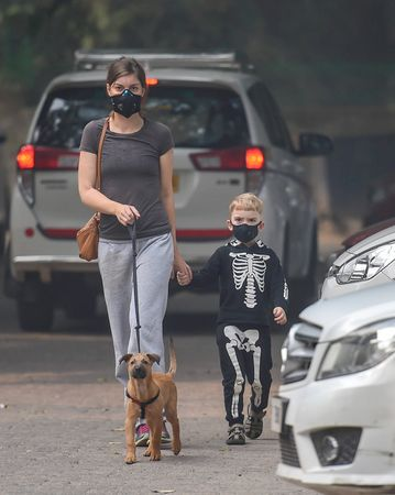 Face brace: Morning walkers wearing masks to deal with the pollution in Delhi | PTI