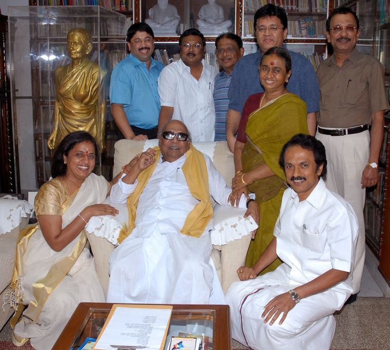 Family's man: Karunanidhi flanked by daughter Selvi, wife Dayalu Ammal and son Stalin; (behind, from left) grand-nephew Dayanidhi Maran, son Alagiri, son-in-law Selvam, grand-nephew Kalanidhi Maran and son Tamilarasu; the bronze statue is of Karunanidhi's mother (file photo) | J. Suresh