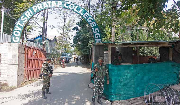 Enforcing peace: Security personnel near a bunker outside the main gate of a college in Srinagar | Umer Asif