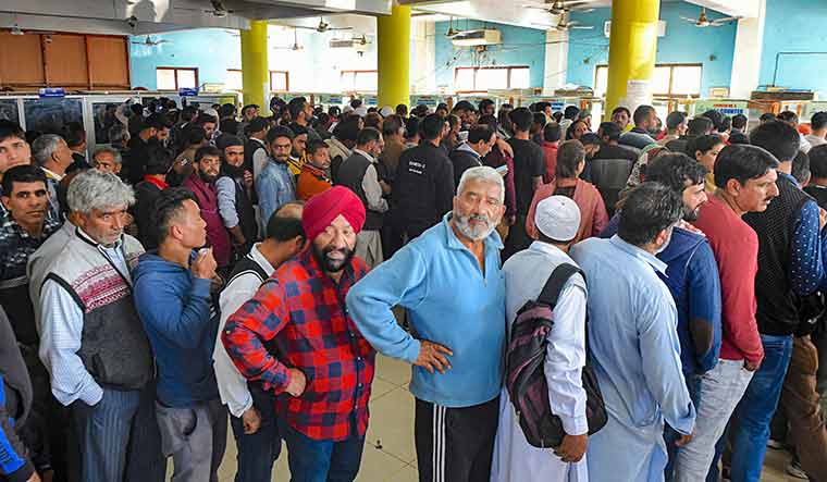 Risky business: People queueing for restoring their cellphone connections in Srinagar on October 14. Many migrant workers have chosen to stay in Kashmir even though there are safety concerns | PTI