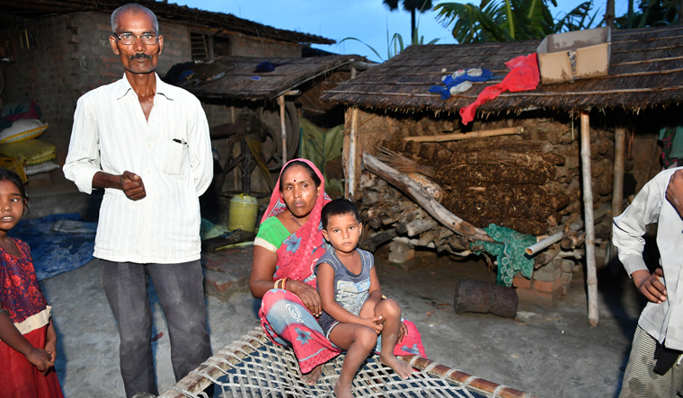 Close escape: Suresh Sahni with his wife and daughter, who had fever and seizure, at home in Harivanshpur village | Arvind Jain
