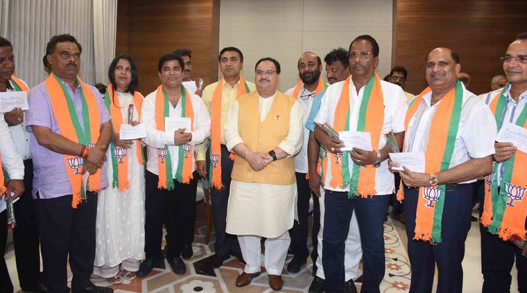 Pull of power: Ten Congress MLAs joining the BJP in the presence of party working president J.P. Nadda in Delhi.