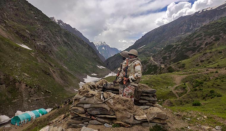 Safe passage: Indo-Tibetan Border Police personnel stand guard along the route to the Amarnath shrine | PTI