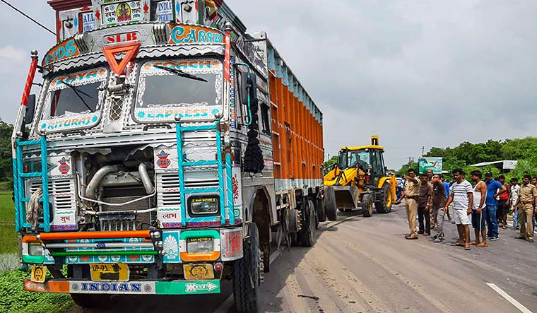 On a collision course: The truck that rammed into the car (below) that the rape survivor, her aunts and lawyer were travelling in | PTI