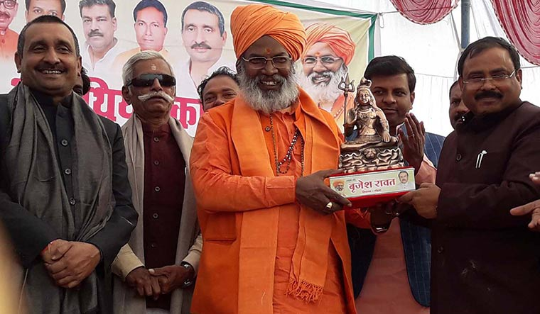Clout rules: Unnao MP Sakshi Maharaj with Kuldeep Singh Sengar (far left) at a felicitation ceremony in Mohan, Unnao, soon after the BJP formed government in the state in 2017 | Shubham nigam