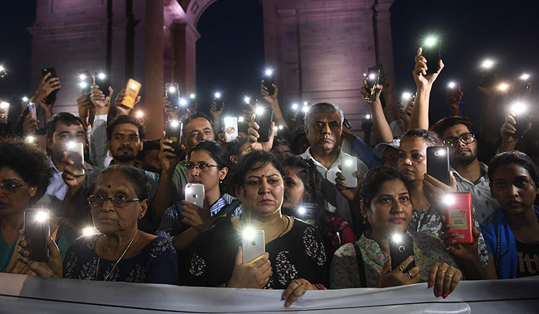 In solidarity: Social activists take part in a rally for the Unnao rape survivor in front of India Gate, New Delhi | AFP