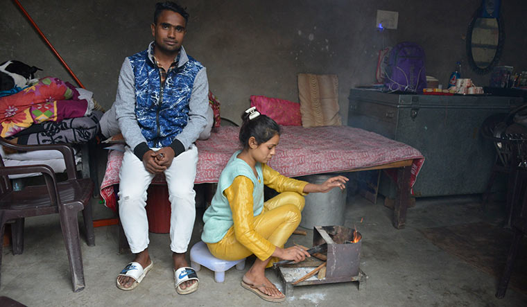 On their own path: Pawan's son, Basu, and daughter, Vandana, at their home in Meerut. None of Pawan's seven children wants to carry forward his profession | Arvind Jain