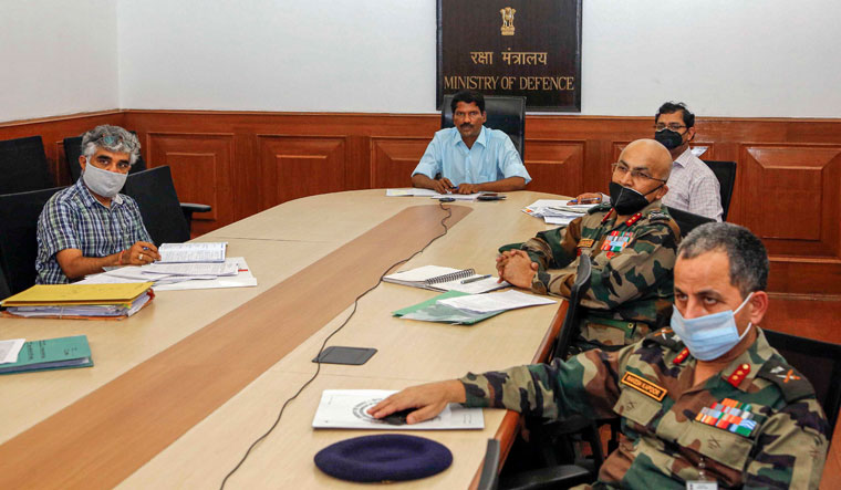 Talk time: Additional Secretary (department of defence production) V.L. Kantha Rao along with officials from the DDP, defence ministry and other senior civil and military officials during a videoconference with employees of the ordnance factory board in New Delhi | PTI