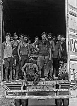 Daily-wage workers en route to Lucknow. They travelled 2,000km in three days in a container.