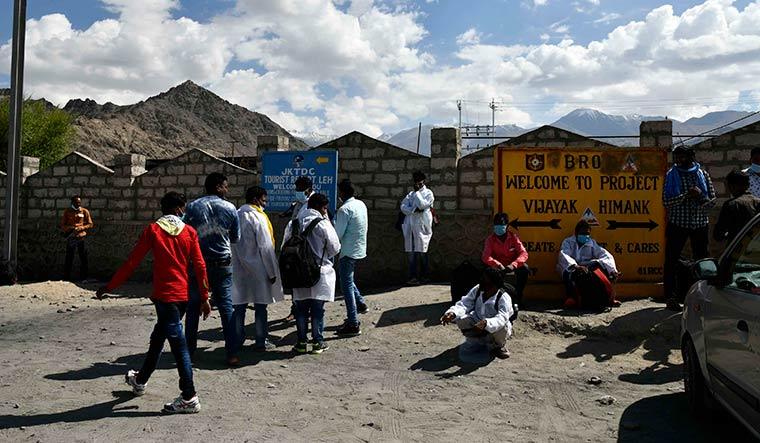 Connecting lives: Contract workers of Border Roads Organisation from Jharkhand waiting for transport in Leh.