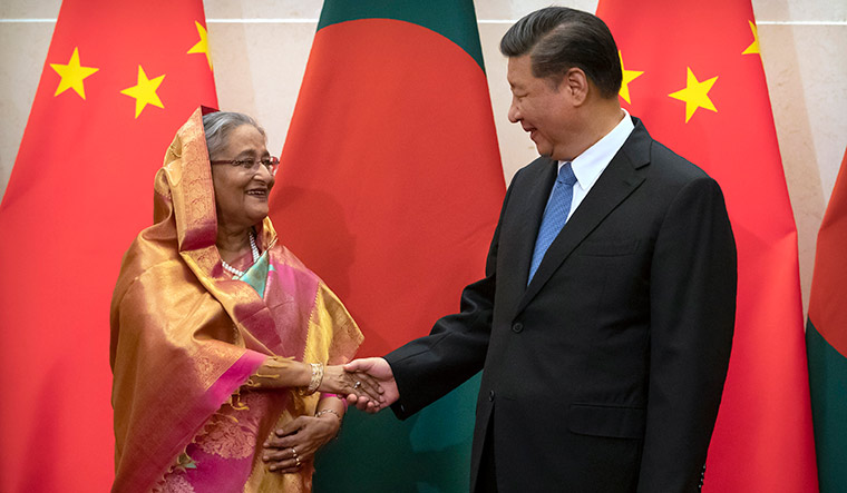 Tactical friendship: Bangladesh's Prime Minister Sheikh Hasina (left) with Chinese President Xi Jinping. Bangladesh is in talks with China to finance a project on the River Teesta | Getty Images