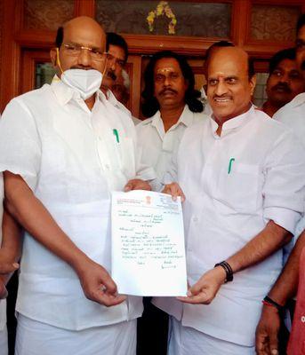 Greener pastures: Congress MLA K. Lakshmi Narayanan (right) submits his resignation to Speaker V.P. Sivakolundhu | PTI