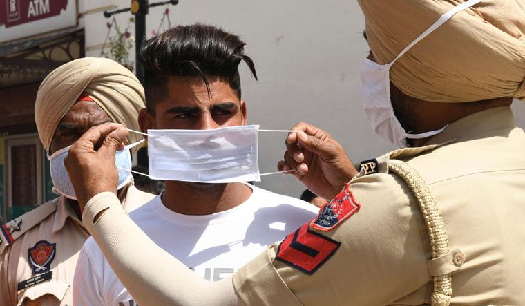 'Force'd masking: An awareness campaign in Amritsar | AFP