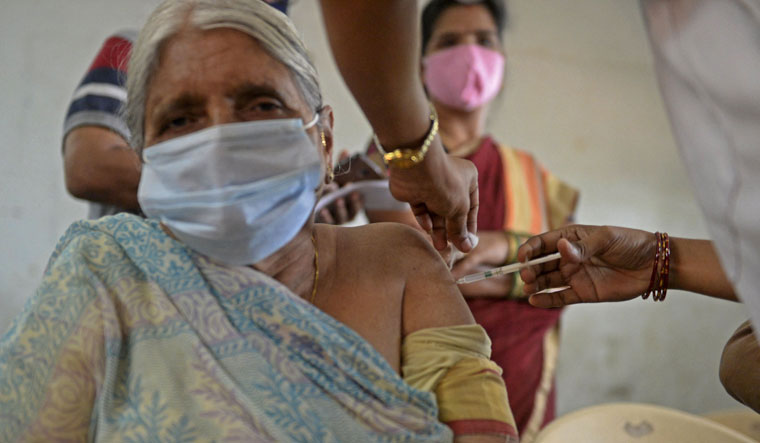 Drive on: Vaccination under way at a government high school in Hyderabad   AFP