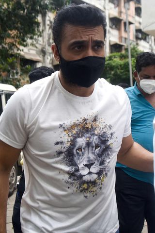 Caught in a web: Police escort Raj Kundra in Mumbai   AFP