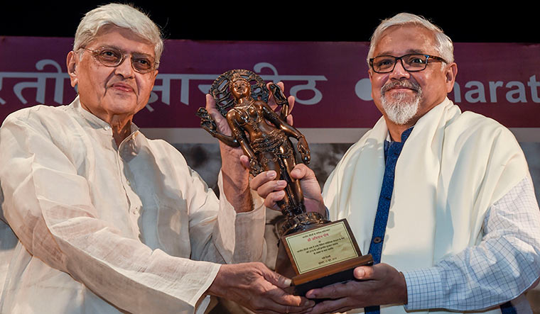 Words as wisdom: Amitav Ghosh receiving the Jnanpith from former West Bengal governor Gopalkrishna Gandhi on June 12 | PTI