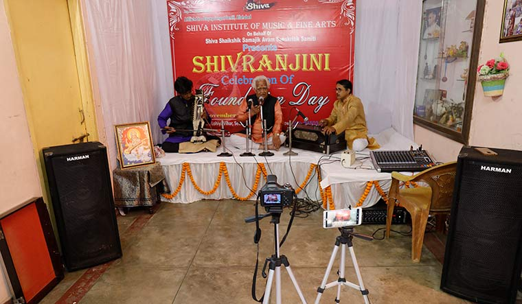 Adapt to survive: Rameshwar Prasad Mishra (centre) and Pramod Upadhayay (right) perform for an online event in Lucknow   Pawan Kumar