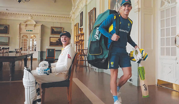 Skippers and smiles: Steve Smith (sitting) and Tim Paine.