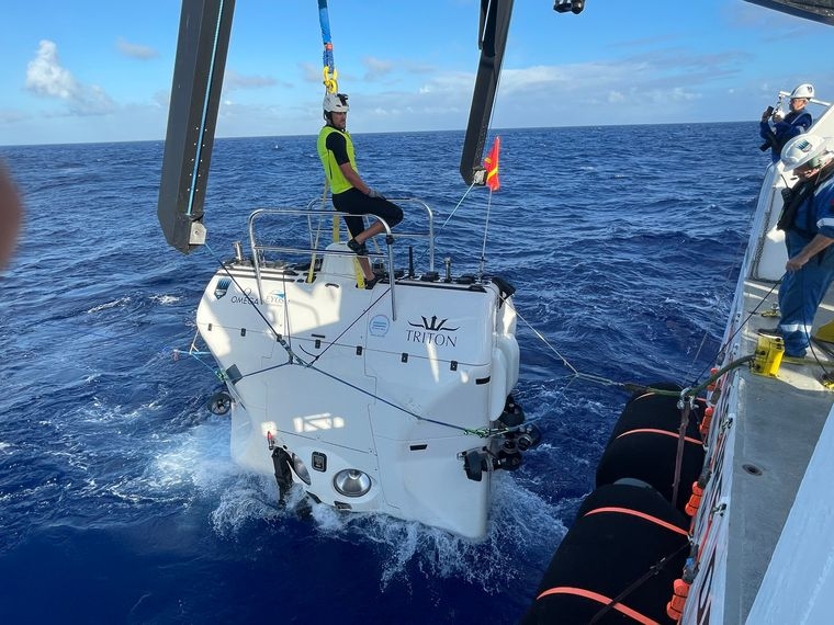 The submersible being lowered from the mothership   Giles Harding