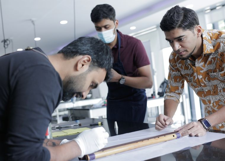 Parth Chandiramani with chef Vinesh Johny (left) as he puts the finishing touches | Lavonne Academy