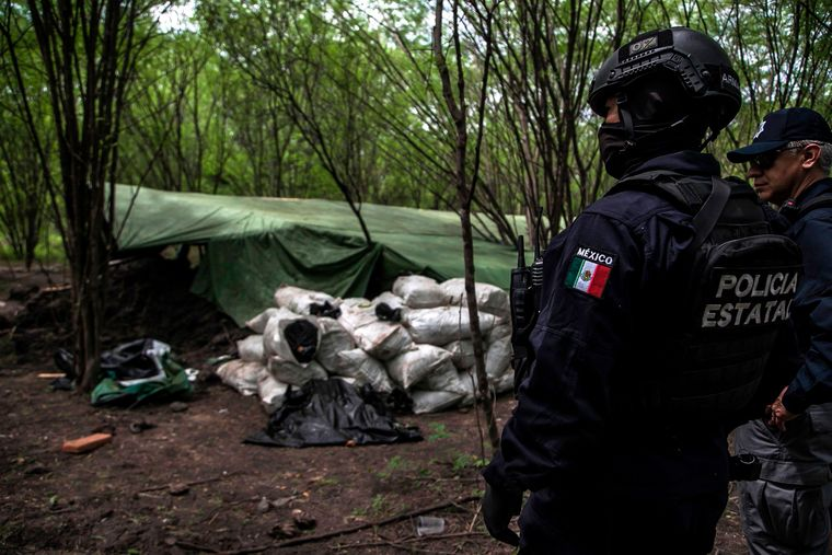 Fatal fight: An anti-drug operation in Carrizalejo, Sinaloa state, Mexico. Drug trafficking in Mexico is driven by the large-scale consumption by the Americans | AFP
