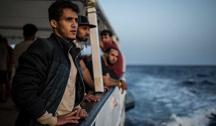 At sea: Immigrants onboard the NGO Proactiva Open Arms boat | AFP