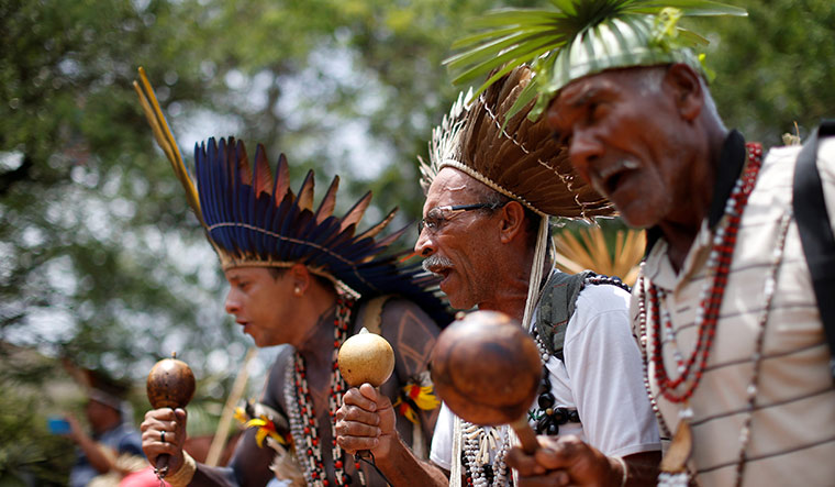 Real concern: indigenous people from various tribes wait to give a petition to Bolsonaro | Reuters