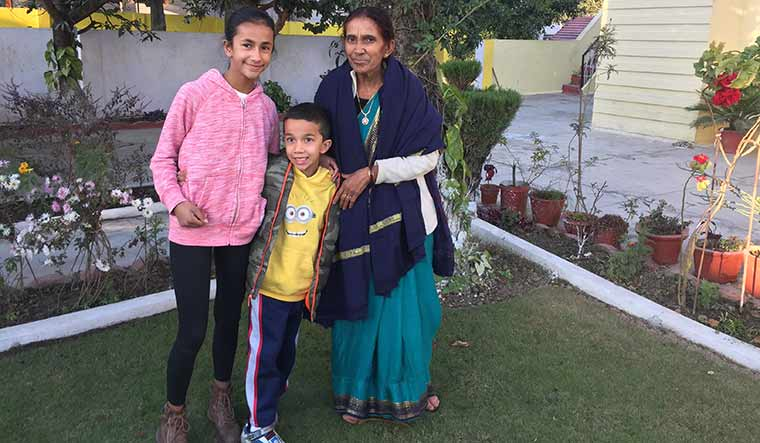 Boundless Love: Tyagi's children Lavinia Elizabeth and Atticus Mann with his mother.