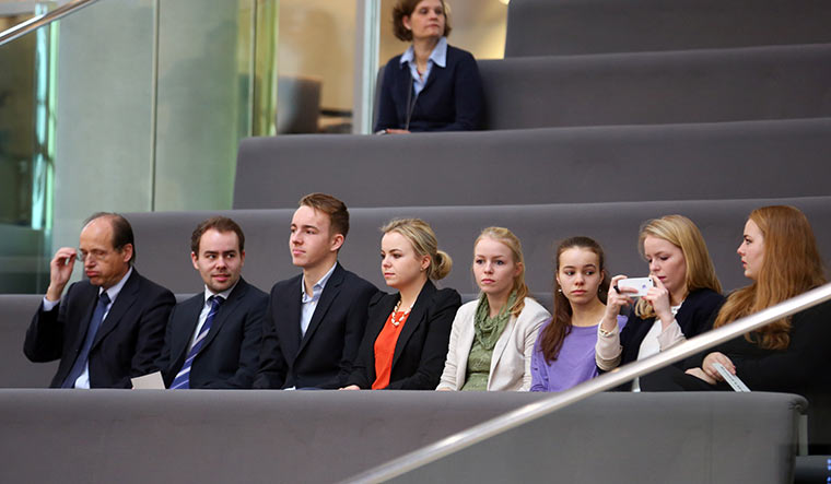Family woman: Ursula von der Leyen's husband, Heiko, and their seven children in the stands of the German Parliament in December 2013   Getty Images