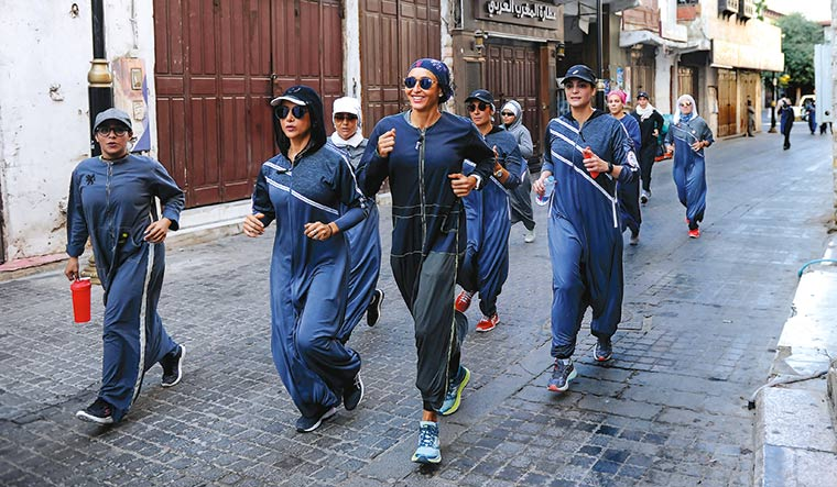 Women wearing sports abaya jog in the streets of Jeddah's historic al-Balad district | Getty Images