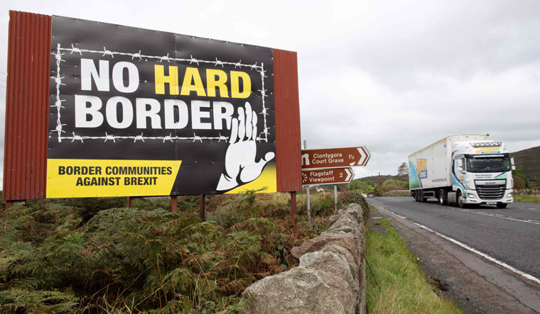 Knotty ties: an anti-brexit billboard on the border between ireland and northern Ireland. Maintaining sovereignty while keeping borders open with Ireland is a key challenge for the Johnson government | AFP