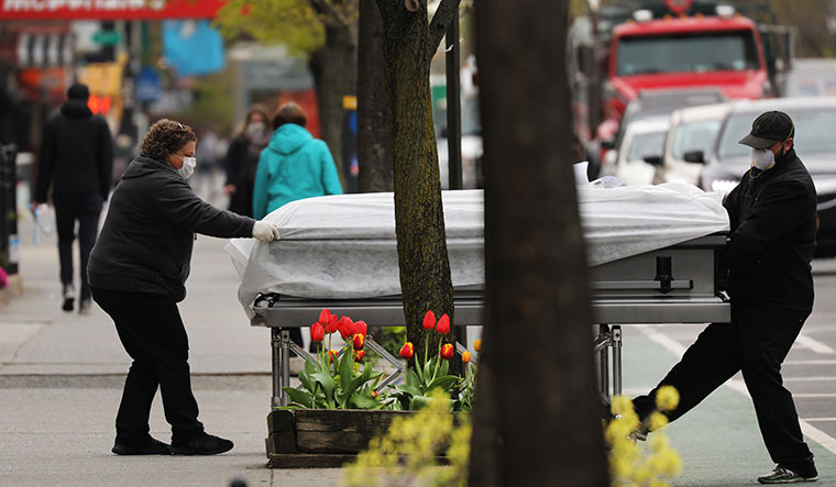 Last journey: A casket is delivered to a funeral home in Brooklyn in New York City | AFP
