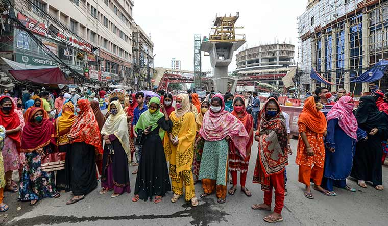 Anger and agony: Garment factory workers in Dhaka during a demonstration demanding payment of wage dues   AFP